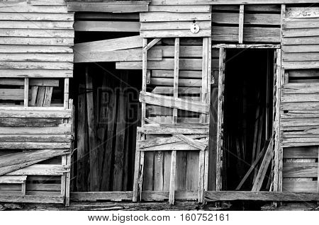 Close-up black & white image of old wood shed in disrepair.