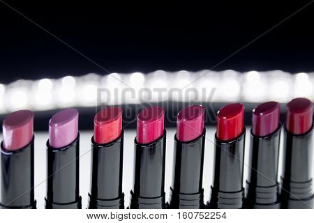 Set Of Matte Lipstick In Red And Natural Colors On White  Black Background. Fashion Colorful Lipstic