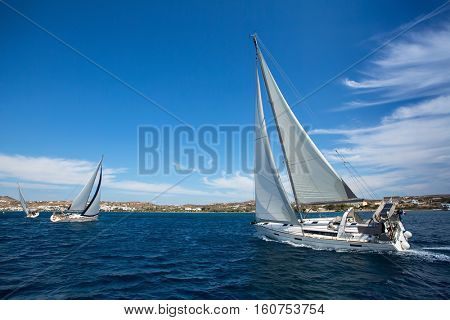 Luxury yachts at Sailing regatta. Sailing in wind through waves at Sea.