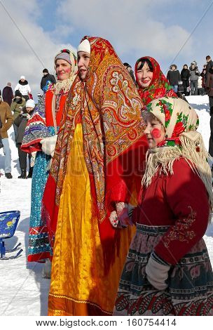 Gatchina, Leningrad region, Russia - March 5, 2011: Maslenitsa. a traditional spring holiday at the Russian peoples. Women in ancient Russian outfits.
