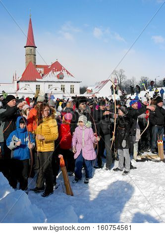 Gatchina, Leningrad region, Russia - March 5, 2011: Maslenitsa. a traditional spring holiday at the Russian peoples. Popular entertainment - archery.