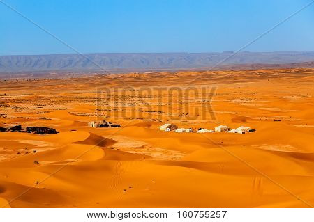 Sand Dunes And Nomad Camp In The Sahara Desert, Merzouga, Morocco