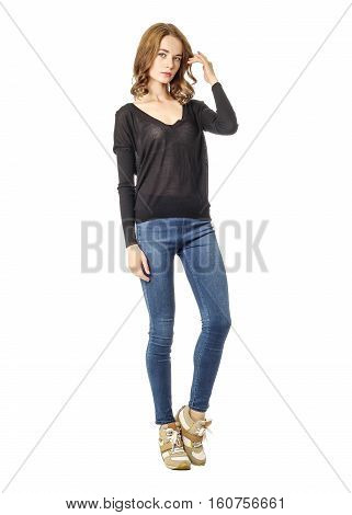 Young Brunette Girl Standing In Blue Skinny Jeans