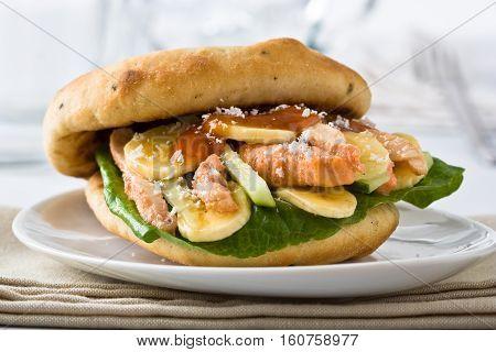 Inidan style sandwich with chicken mango and banana dressed with mango chutney.
