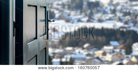Opened Door Concept To Beautiful And Imaginary Snowy Village Landscape