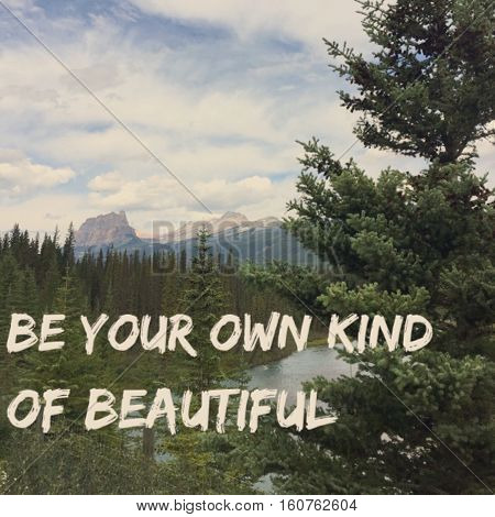 Inspirational quote. Motivational quote on mountain landscape with forest and tall tree in foreground. Be your own kind of beautiful. Instagram effects.