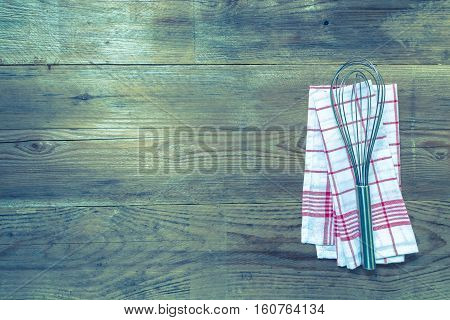 Red Kitchen Towel With Whisk On A Wood Wood Background