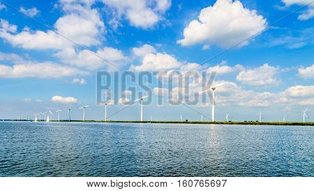 Wind Turbines, the modern Windmills, in a Wind Farm along the Shore of Veluwemeer in the Netherlands