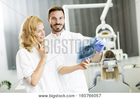 Dental Specialist Examine An X-ray Of The Tooth
