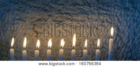 Glitter light of candles as traditional symbol for Hanukkah holiday