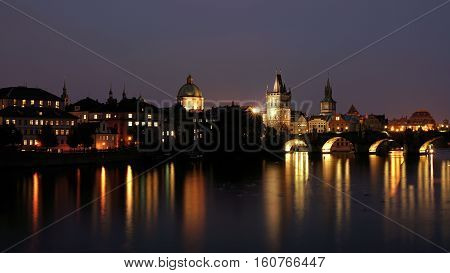 Cityscape of Prague with Charles Bridge at night