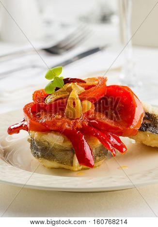 Fried conger with bell pepper tomato and garlic