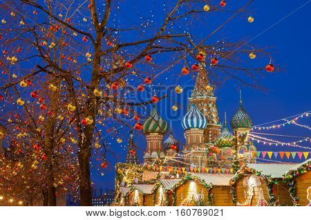 Christmas decorations at the Red Square with St. Basils Cathedral on the background Moscow Russia