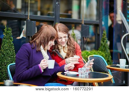 Two Beautiful Young Girls Drinking Coffee