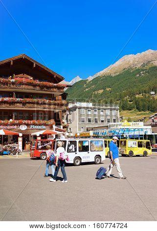 Bus And Tourists At City Center Of Zermatt Valais