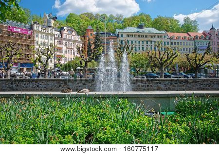Fountain At Tepla River And Promenade In Karlovy Vary