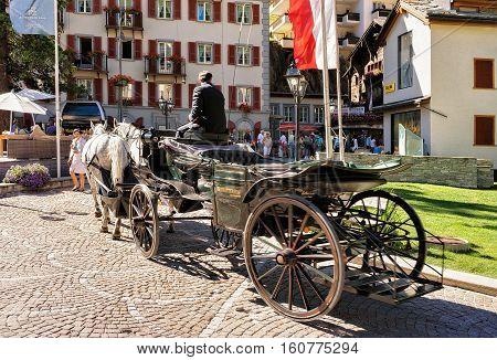 Horse Vehicle And Tourists At City Center Zermatt Swiss