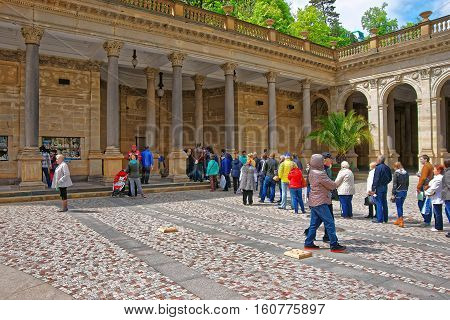 People Staying In Queue At Mill Colonnade In Karlovy Vary