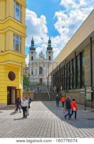 Saint Mary Magdalene Church And Promenade In Karlovy Vary