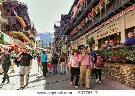 Asian Tourists At City Center Of Zermatt Valais