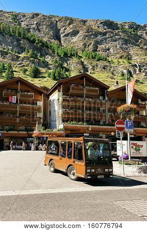 Zermatt Switzerland - August 24 2016: Bus with Tourists at City center of Zermatt Valais canton in Switzerland in summer.
