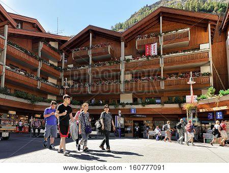 Family Of Travelers At Tourist Information Office In Zermatt
