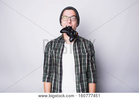 Young Guy With Eyeglasses Holding Joystick