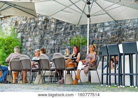 People At Street Restaurant In Ascona Town Of Switzerland