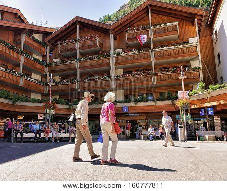 Senior Travelers At Tourist Information Office In City Center Zermatt