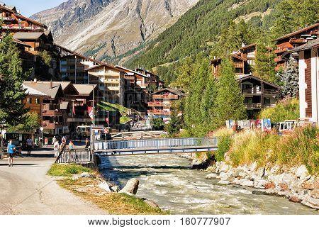 Tourists At Town Center Zermatt