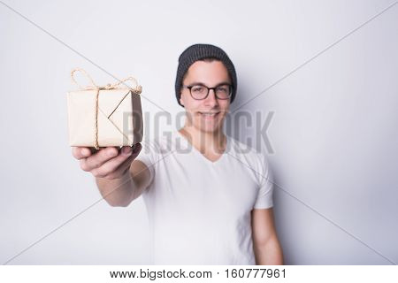 Excited Young Man Holding Present Isolated On White Background
