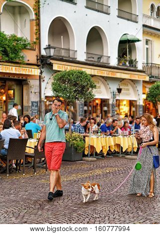 Tourists With Pet On Promenade In Ascona