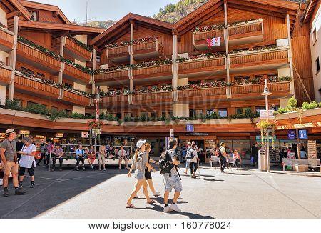 Travelers At Tourist Information Office In City Center Of Zermatt