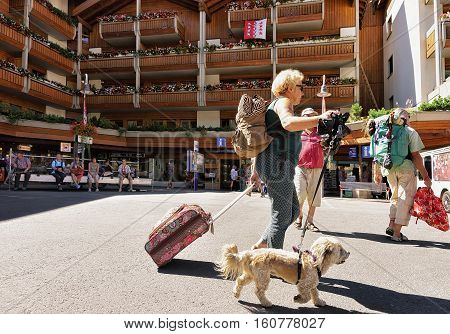 Travelers With Pet At Tourist Information Office In Zermatt