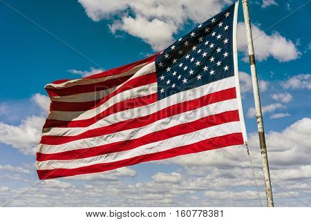 American National Flag In Front Of Boston Sky