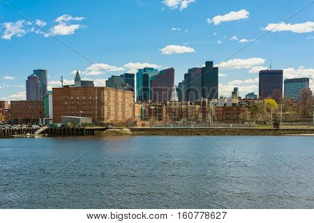 Buildings Near River And The Skyline Of Boston