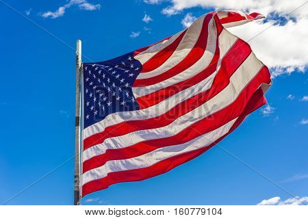 Flag Of The United States In Front Of Boston Sky