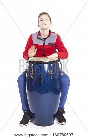 teenage caucasian plays the conga in studio with white background