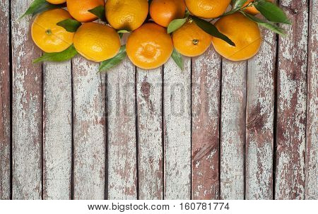 Mandarins. Tangerines close-up on a wooden background. Background tangerines. Top view with copy space.