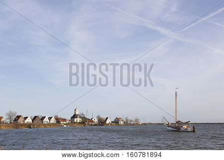 old wooden sailing boat on IJmeer near Durgerdam and amsterdam in holland