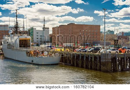 White Ship Moored Near The Pier In Boston