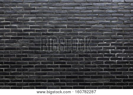 background consisting of horizontal part of black wall build of black bricks
