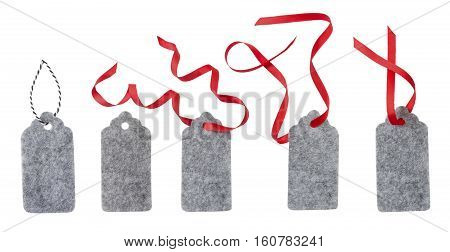 Set of color gift tags isolated on white background. Sale labels. Price tags. Special offer and promotion. Store discount shopping time. Gift labels isolated on white. Label from gray felt.