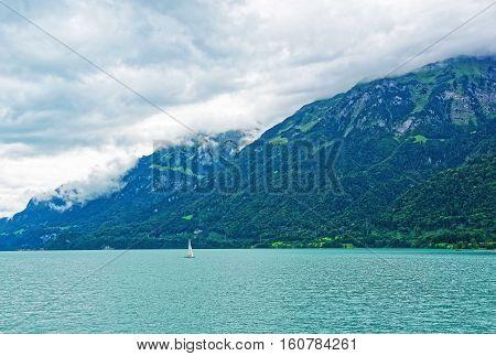 Sailboat At Lake Brienz And Brienzer Rothorn Mountain Bern Switzerland