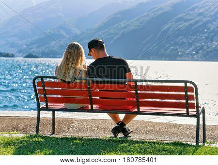 Couple Sitting On Bench In Ascona Switzerland