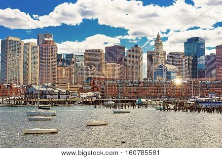 Floating Boats And Ships In Front Of The Boston Skyline