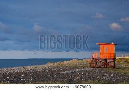Orange lifeguard station on empty beach of Batumi, Georgia
