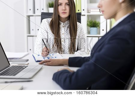 Serious businesswoman is looking at you with contempt. She knows what you have done and is not impressed. Concept of blaming