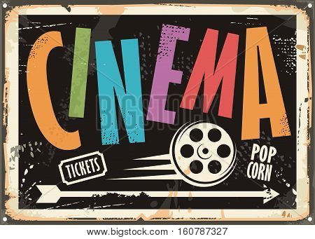 Cinema vintage signboard design concept with colorful text and film roll on black background. Vector illustration.