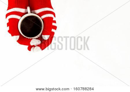 Christmas Card, Gloves On Hands Holding Cup Of Cofee Isolated On A White Background With Space For T